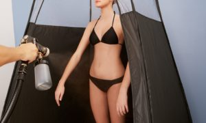 Spray Tanning in Tent